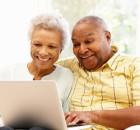 Senior African American couple using laptop